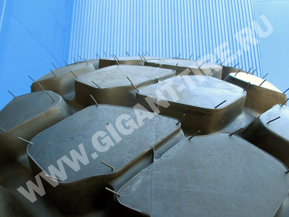 Резиновые усики на новой шине Bridgestone 24.00 R35 VMTS E2A E-4
